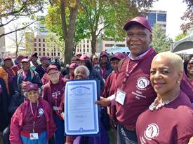 A group of Detroit Area Agency on Aging volunteers outside at an event.