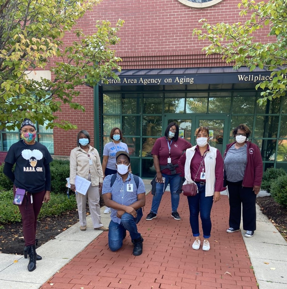 7 individuals standing outside of the Detroit Area Agency on Aging building with masks on. COVID-19 protocols.